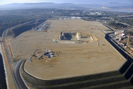 Looking south over the ITER site in January 2011. Work is progressing on the excavation of the Tokamak Complex (centre), the Poloidal Field Coil Winding facility (left), and the ITER Headquarters (right). Photo: Altivue