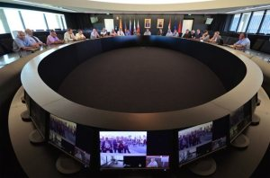 The Fellowship - Some 25 former members of JET's staff gathered in the ITER Council Room, connected to Culham by video link. Photo Credit: ITER.Org