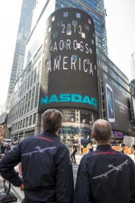 Across America_Solar Impulse at NASDAQ opening bell ceremony_Bertrand Piccard and André Borschberg in Times Square in front of the NASDAQ tower_09.07.2013